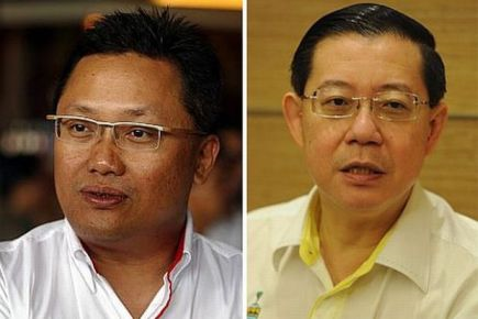 Abdul Rahman Dahlan (kiri) dan Lim Guan Eng (kanan)