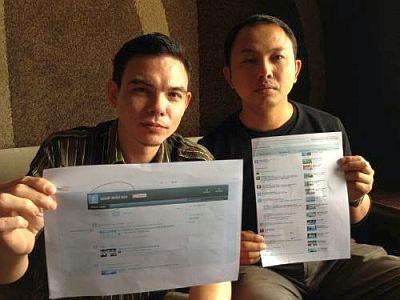 Yasin (kiri) dan Yusmadi menunjukkan bukti ugutan bunuh yang diterima menerusi laman YouTube.