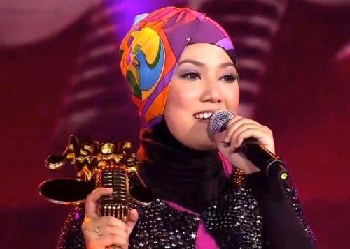 Shila Amzah ketika diumumkan sebagai juara Asian Wave 2012 yang berlangsung di Shanghai, China, malam Khamis lalu.
