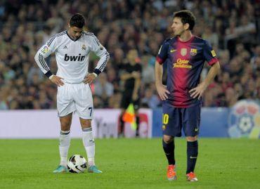 Ronaldo (kiri) dan Messi (kanan) masing-masing menjaringkan dua gol pada perlawanan La Liga, awal pagi Isnin.